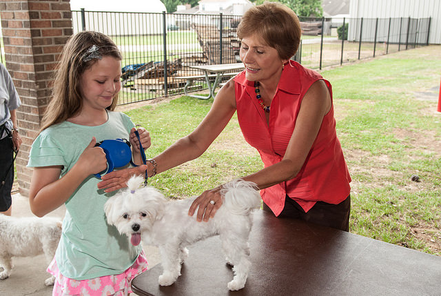 Prayer Ministry Director Jan Niel blesses a young girl's dog at the 2014 Blessing of the Animals.